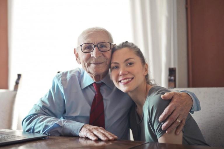 Litseto-na-dobroto-positive-senior-man-in-formal-wear-and-eyeglasses-hugging-3823497-2048x1365